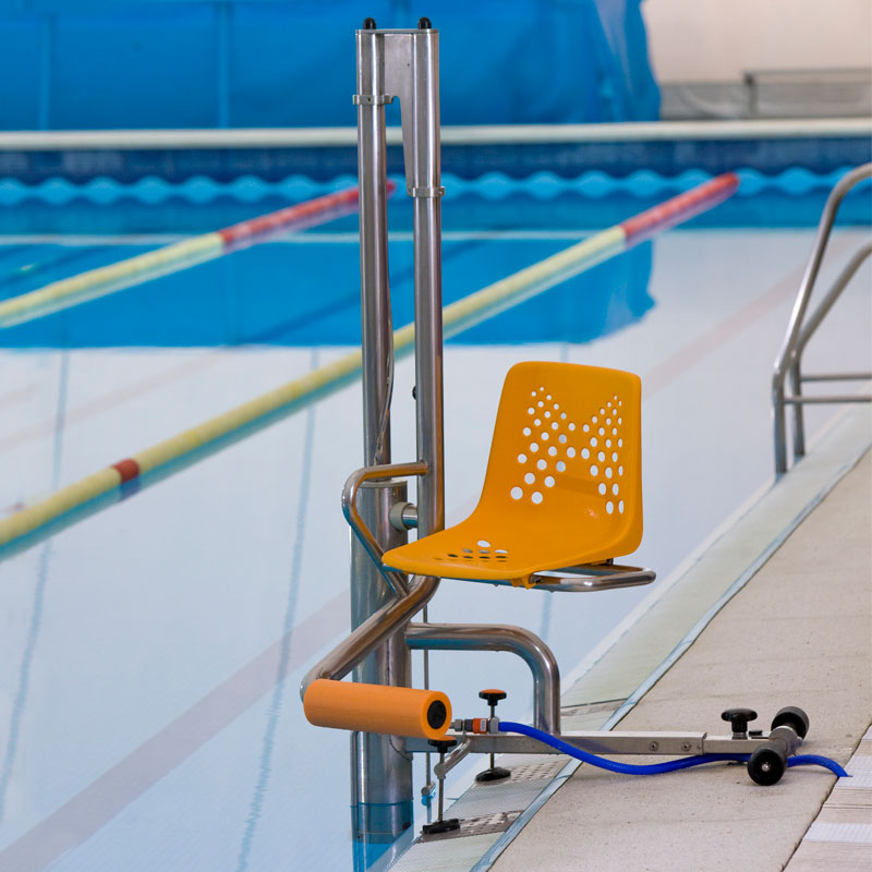 Swimming pool lift installed in swimming pool for collective use.